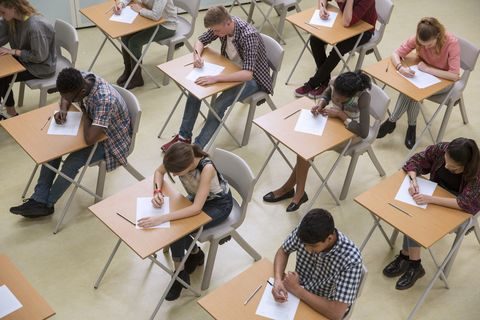 Elevated view of students writing their GCSE exam