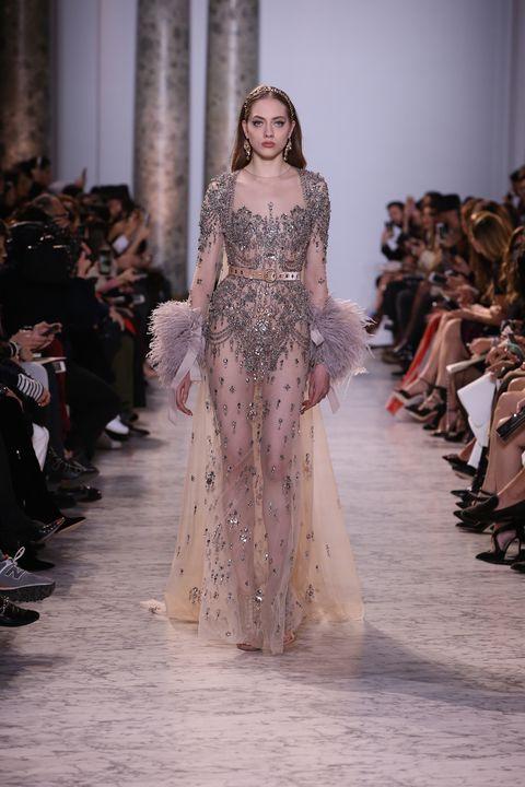 Fashion show, Shoulder, Dress, Runway, Style, Formal wear, Gown, Fashion model, Fashion, Beauty,