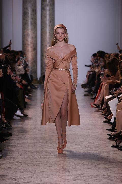 Footwear, Fashion show, Brown, Runway, Shoulder, Joint, Outerwear, Style, Fashion model, Waist,