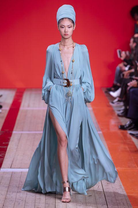 Fashion model, Fashion, Clothing, Runway, Fashion show, Haute couture, Dress, Fashion design, Outerwear, Formal wear,