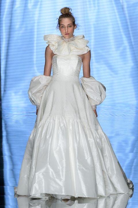 Wedding dress, Gown, Dress, Clothing, Fashion model, White, Bridal clothing, Bridal party dress, Fashion, Shoulder,