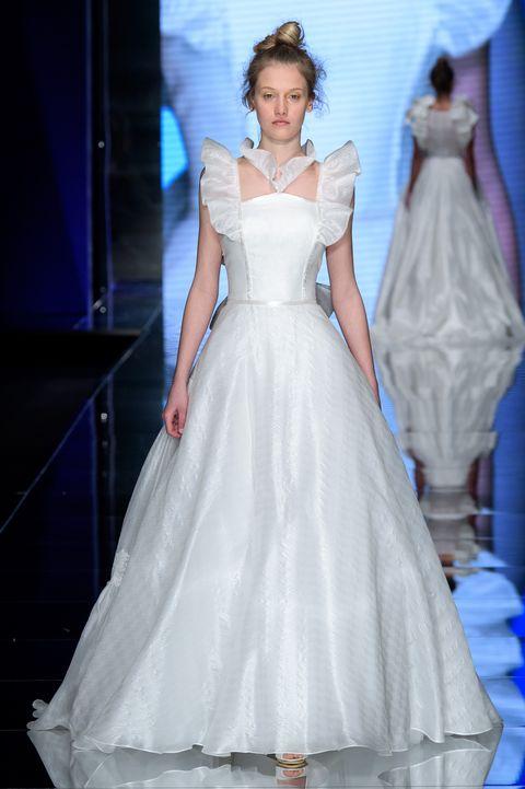 Gown, Wedding dress, Dress, Fashion model, Clothing, Bridal clothing, Shoulder, Fashion, Haute couture, Bride,