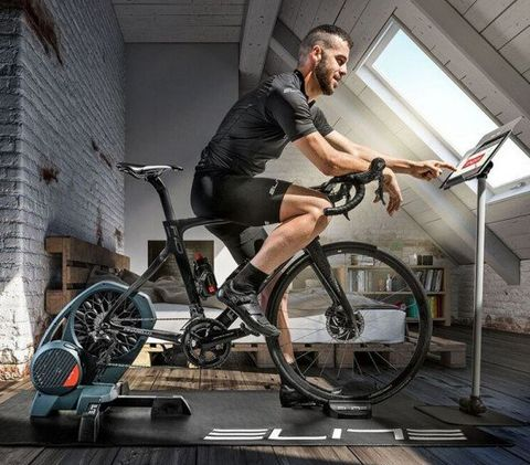 Bicycle, Bicycle wheel, Vehicle, Bicycle accessory, Cycling, Sportswear, Bicycle trainer, Leg, Cycle sport, Recreation,