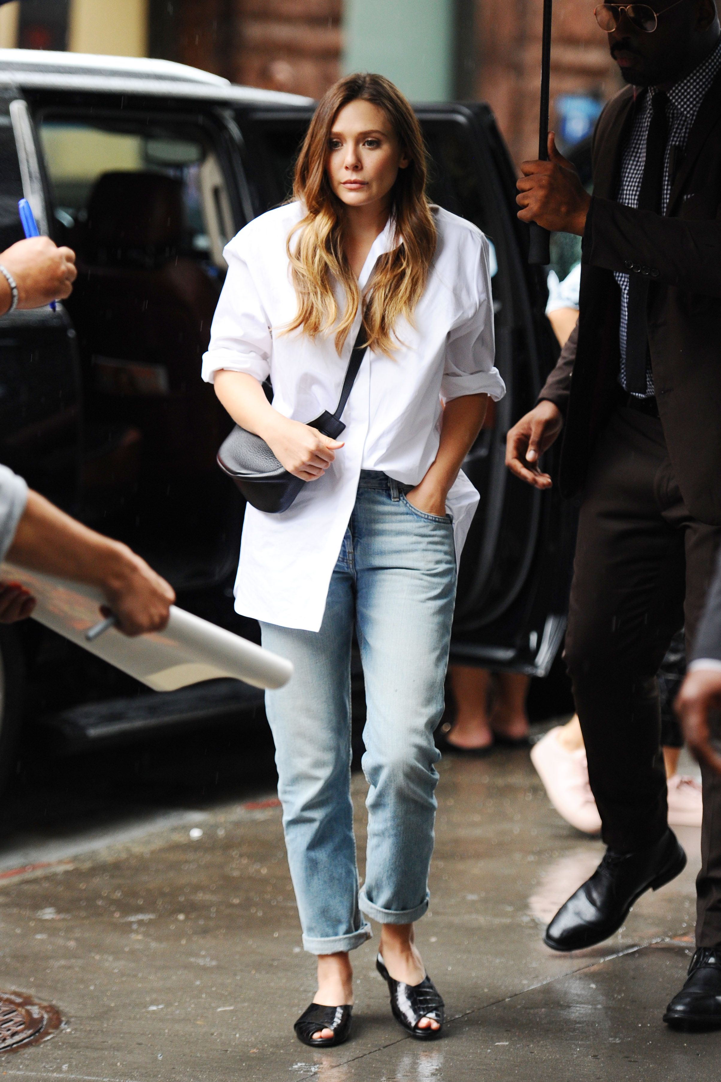 """Elizabeth Olsen The type of outfit you see and think """"damn, this is effortless."""" So long as you have a white button-down (a boxy, oversize one works best) and a pair of non-skinny jeans, you can definitely master this look."""