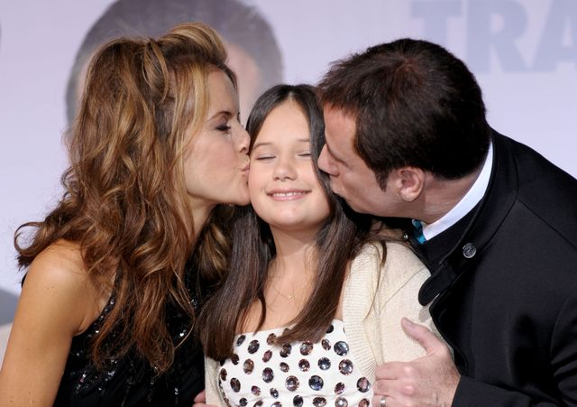 los angeles, ca   november 09  actors john travolta r, wife kelly preston l and their daughter ella bleu travolta arrive at the premiere of walt disney pictures old dogs at the el capitan theater on november 9, 2009 in los angeles, california  photo by kevin wintergetty images