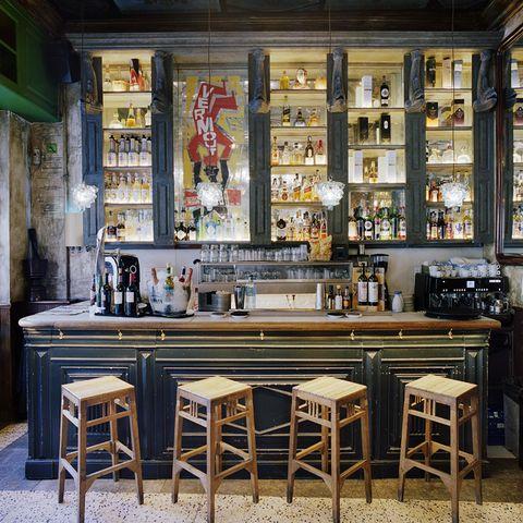 Building, Furniture, Table, Room, Interior design, Bar, Restaurant, Bar stool, Coffeehouse, Barware,
