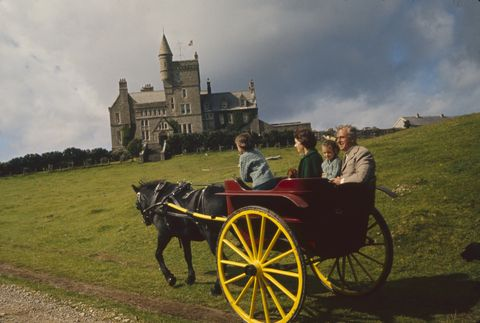 as they approach classiebawn castle, louis mountbatten, 1st earl mountbatten of burma 1900   1979 right rides in a horse drawn wagon with his daughter, lady patricia bradbourne later 2nd countess mountbatten of burma, and her children, joanna left and amanda, county sligo, ireland, 1963 photo by ralph cranethe life picture collection via getty images