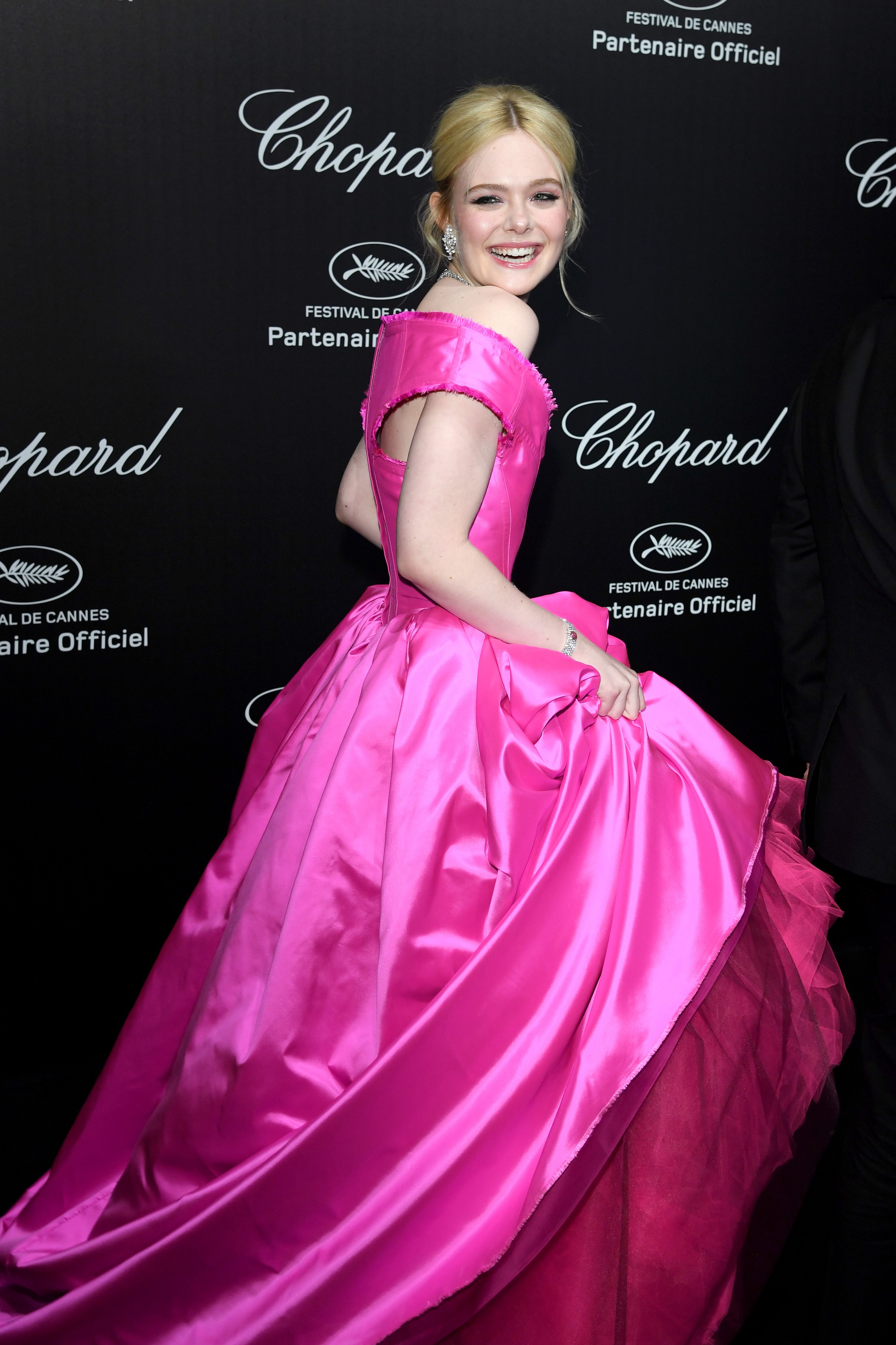 78469967b5f7c Elle Fanning Attends Cannes Film Festival Wearing Pink Vivienne Westwood  Gown