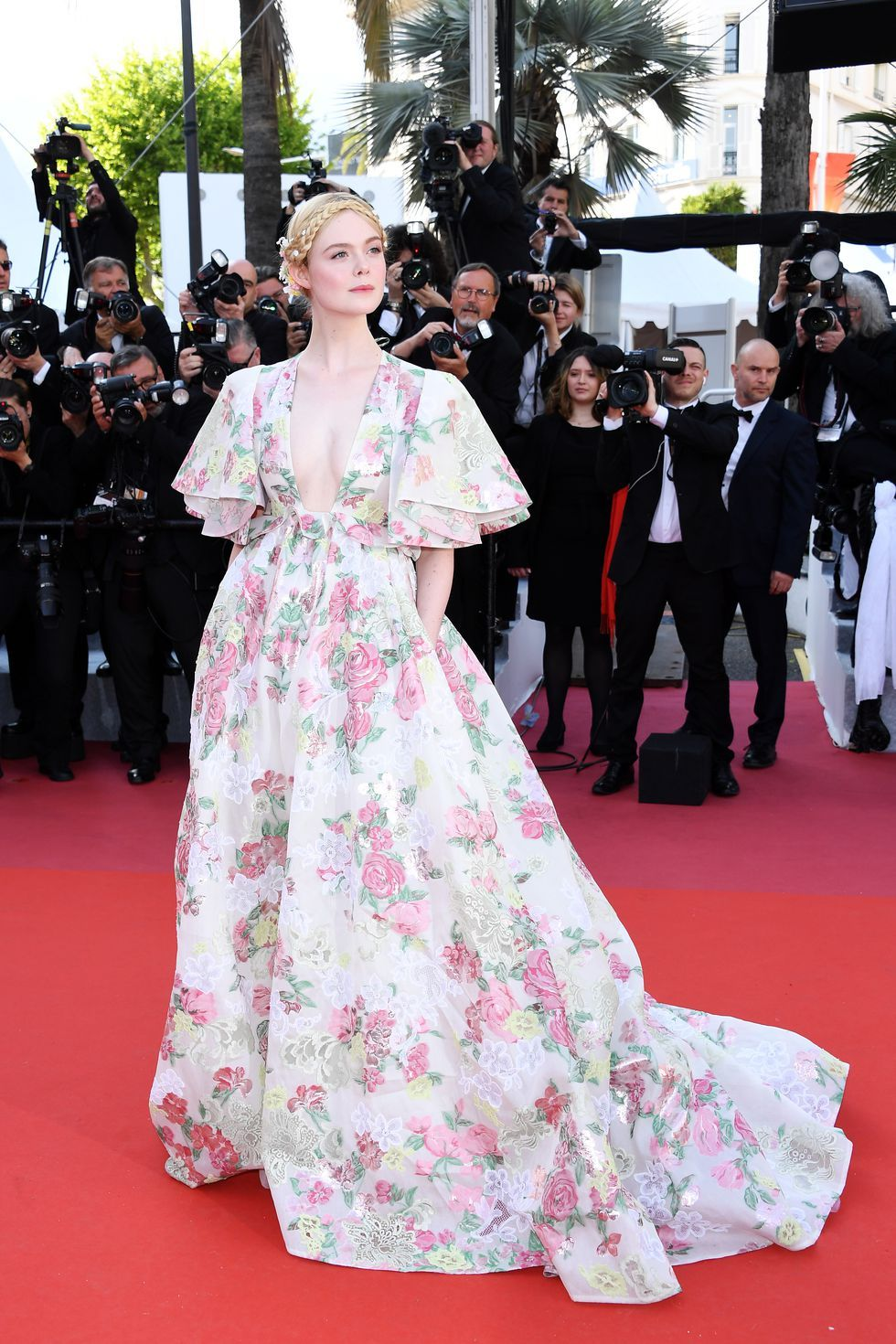 Elle Fanning In Valentino and Chopard jewelry at the premiere of Les Misérables on May 15, 2019.