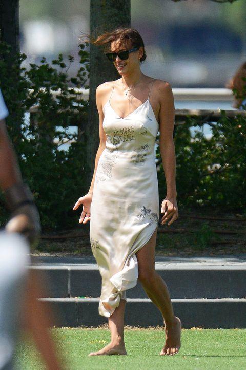irina shayk in a long slip dress and black flat sandals