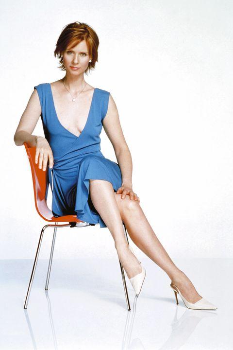 Sitting, Fashion model, White, Blue, Leg, Clothing, Shoulder, Human leg, Beauty, Electric blue,