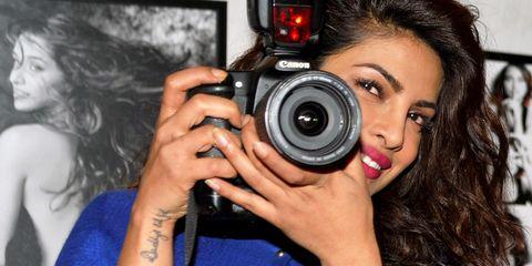Camera, Cameras & optics, Photographer, Camera accessory, Point-and-shoot camera, Camera lens, Digital camera, Photograph, Mirrorless interchangeable-lens camera, Lens,
