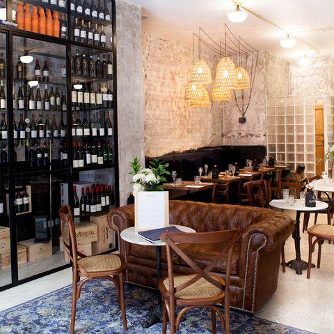Building, Restaurant, Interior design, Furniture, Room, Table, Architecture, Bar, Wine cellar, Distilled beverage,