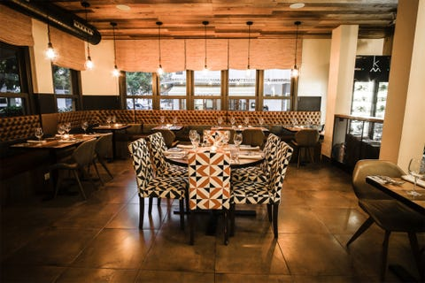 Room, Building, Restaurant, Interior design, Furniture, Table, Floor, Hardwood, Flooring, Wood flooring,