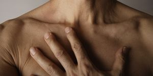 Man's hand on bare chest