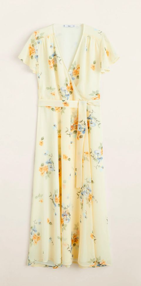 buena reputación precio atractivo de calidad superior Laura Escanes con un vestido amarillo con print floral de ...