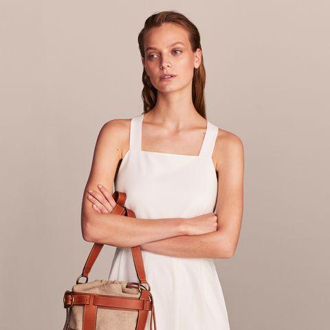 White, Shoulder, Bag, Clothing, Handbag, Fashion model, Fashion, Tan, Dress, Satchel,