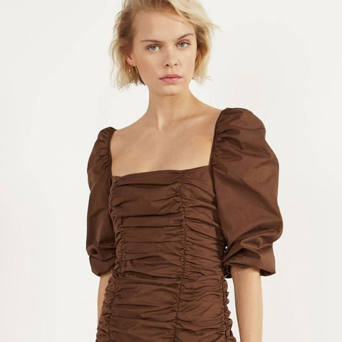 Clothing, Shoulder, Dress, Cocktail dress, Fashion model, Brown, Joint, Day dress, Fashion, Sleeve,
