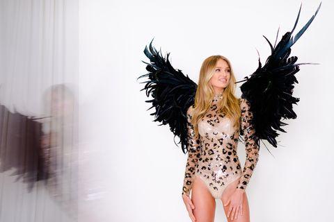 Feather, Wing, Beauty, Fashion, Long hair, Leg, Black hair, Fashion accessory, Fashion design, Photography,
