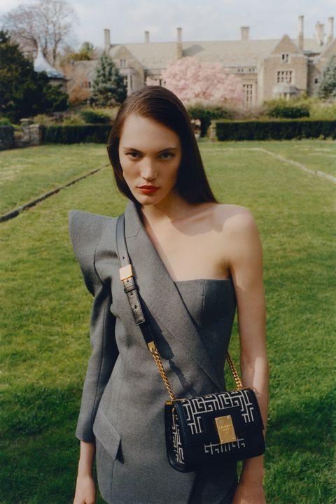 girl in balmain 1945 heritage bag in garden