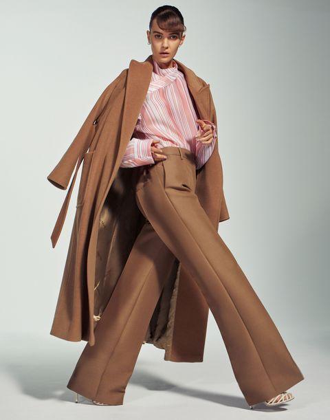 Fashion model, Clothing, Outerwear, Fashion, Brown, Standing, Fashion design, Coat, Leg, Beige,