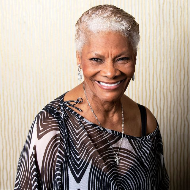 dionne warwick in a white and black top with silver hair