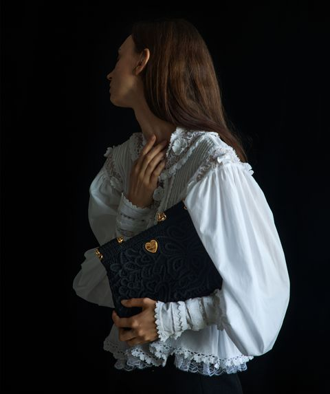 woman in blouse with purse