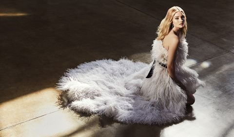 Fashion, Fur, Feather, Leg, Dress, Hand, Photography, Neck, Long hair, Reflection,