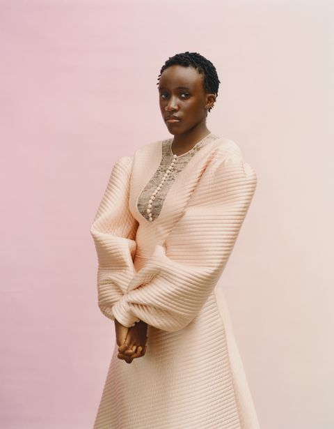 model in pale pink long sleeve dress