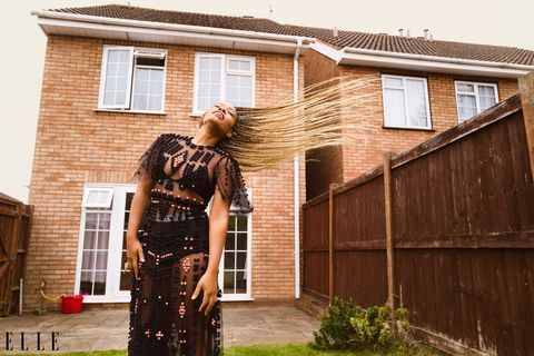 actress weruche opia swings her braids outside in sheer black dress