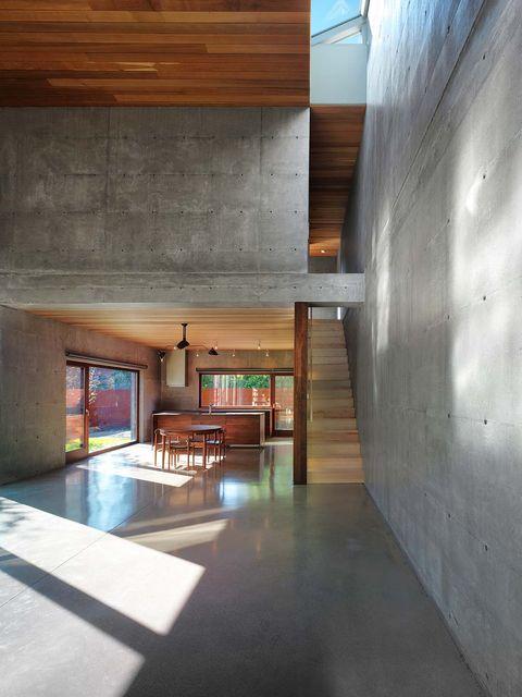 la madera y el hormigón son los sellos de identidad de esta vivienda en canadá