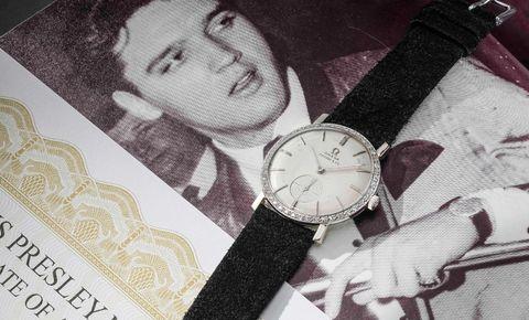 Watch, Watch accessory, Fashion accessory, Analog watch, Wrist, Material property, Jewellery, Photography, Strap, Black hair,