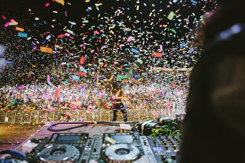 Confetti, Crowd, Audience, Tree, Party supply, Electronics, Plant, Leisure, Festival, Night,