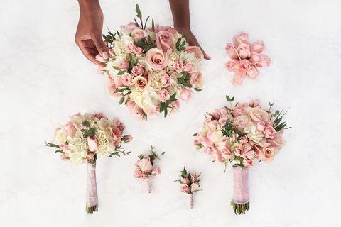 Pink, Bouquet, Cut flowers, Flower, Plant, Peach, Artificial flower, Hand, Floral design, Floristry,