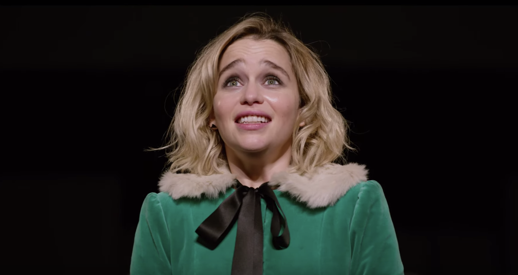 Emilia Clarke sings Wham! classic in new Last Christmas trailer