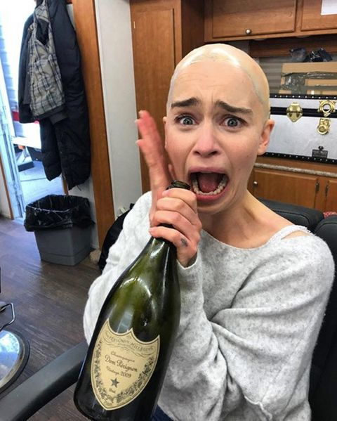 A bald-headed Emilia Clarke behind the scenes of Game of Thrones