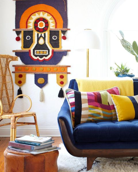 Living room, Furniture, Room, Couch, Orange, Blue, Interior design, Yellow, Wall, Table,