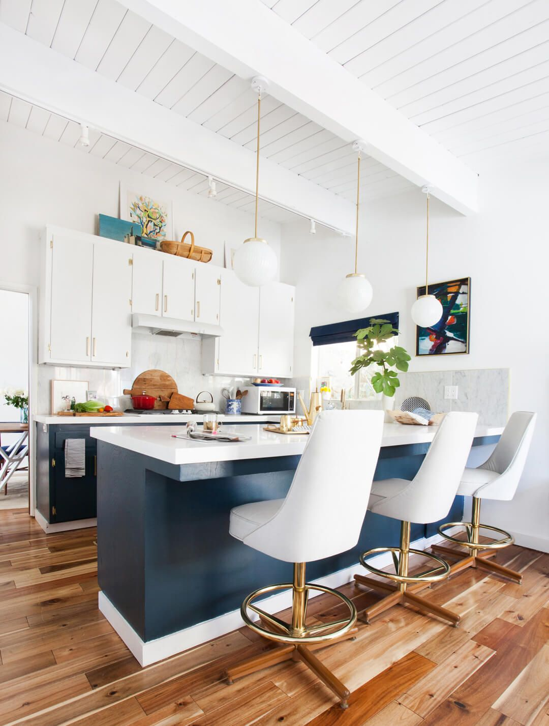 14 ideas for decorating space above kitchen cabinets how to design rh housebeautiful com