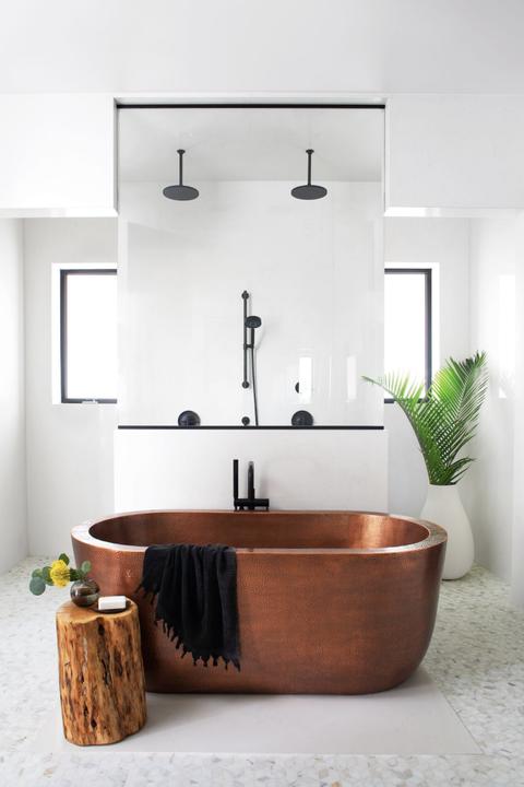 copper tub in a white bathroom