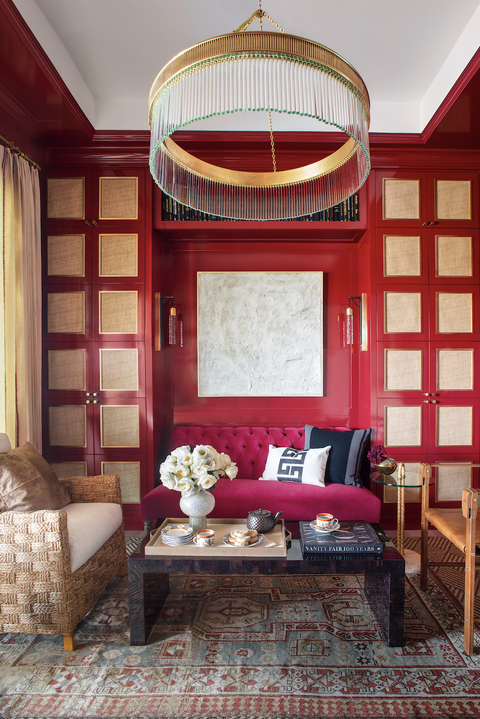tea room with red walls and gold accents