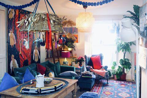 Blue, Lighting, Interior design, Room, Interior design, Furniture, Couch, Living room, Decoration, Lamp,