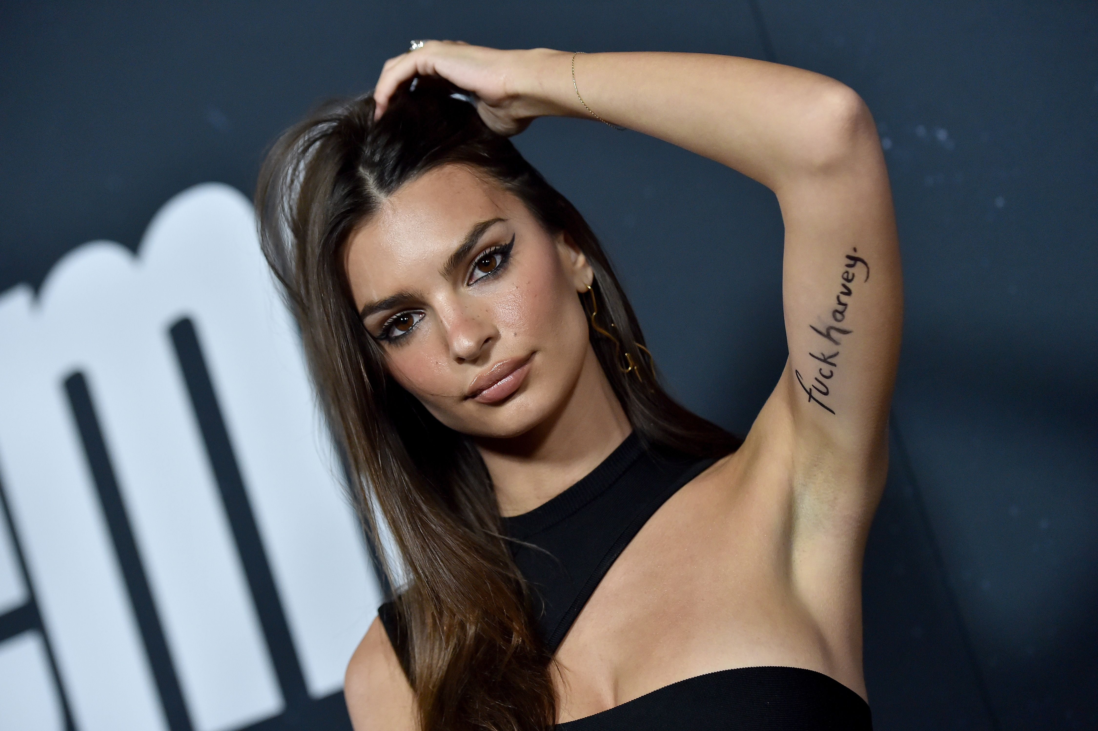 Emily Ratajkowski Walks The Red Carpet With 'F*** Harvey' Inking After Weinstein Settlement Is Revealed