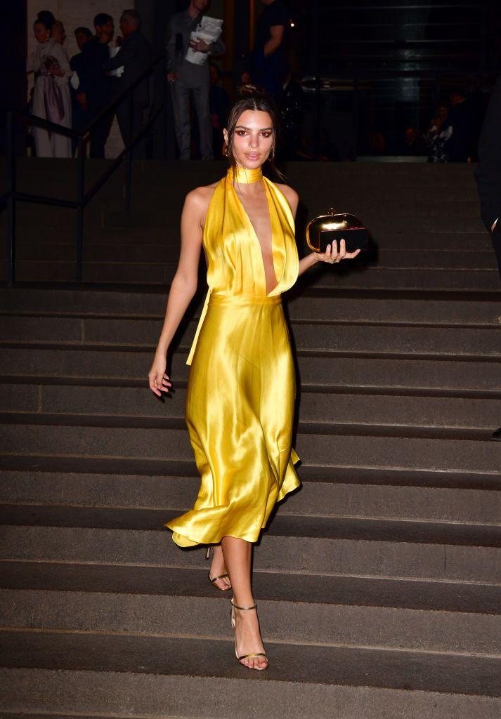 The model and actress wore a Saks Potts yellow satin dress.