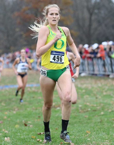 emma abrahamson running at a cross country event