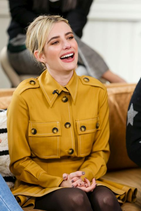 Yellow, Blond, Hairstyle, Sitting, Outerwear, Smile,