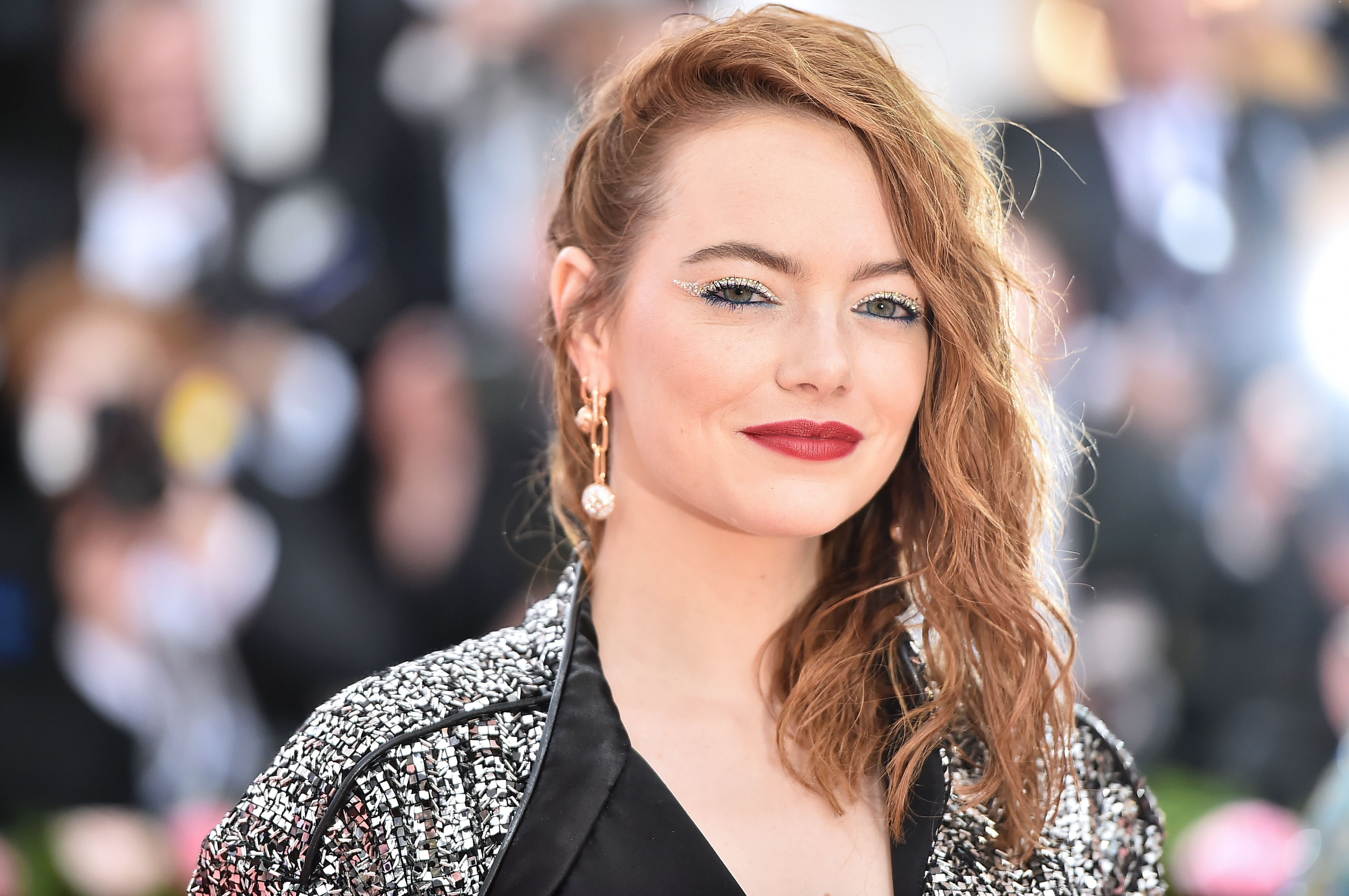 Emma Stone Arrives in the Shiniest Louis Vuitton Jumpsuit to the 2019 Met Gala