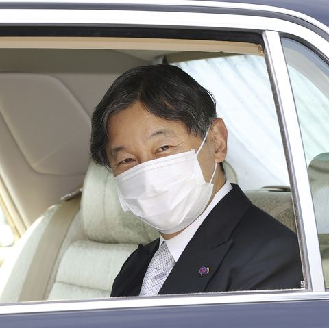 japans emperor naruhito wearing a mask arrives at imperial palace in tokyo on may 1, 2020 an acrylic plate is set to partition the car the yomiuri shimbun via ap images