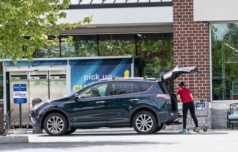 employee puts groceries in car