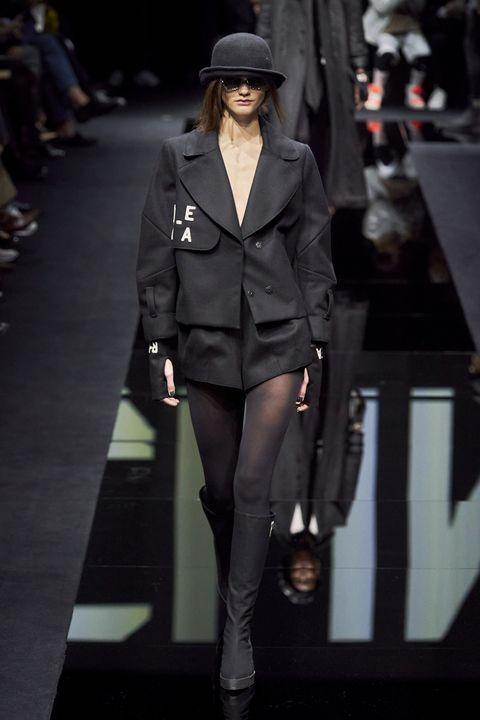 Fashion, Fashion model, Runway, Fashion show, Clothing, Suit, Outerwear, Fedora, Human, Street fashion,