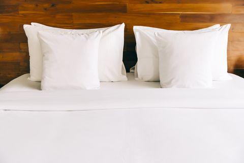 Empty bed in modern hotel room